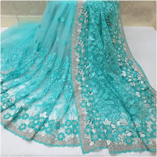 Imposing Sky Blue Colored Nylon Net With Heavy Embroidered Work Saree