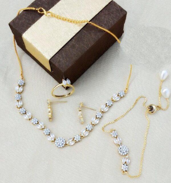 Beauteous Plain Diamond Colored latest necklace design jewelry Set