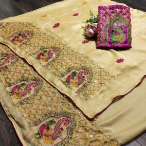 Ravishing Cream Colored Mos Chiffon With Embroidered Work designer fancy saree online