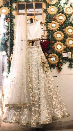 Attractive Cream Colored Silk With Embroidered Work Lehenga Choli Design Online