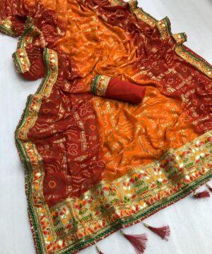 Breathtaking Orange Georgette Bandhani Foil Work Print Mil Designer Saree Online