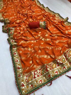 Comely Orange Bandhani Georgette Print Foil Work Designer Saree Online