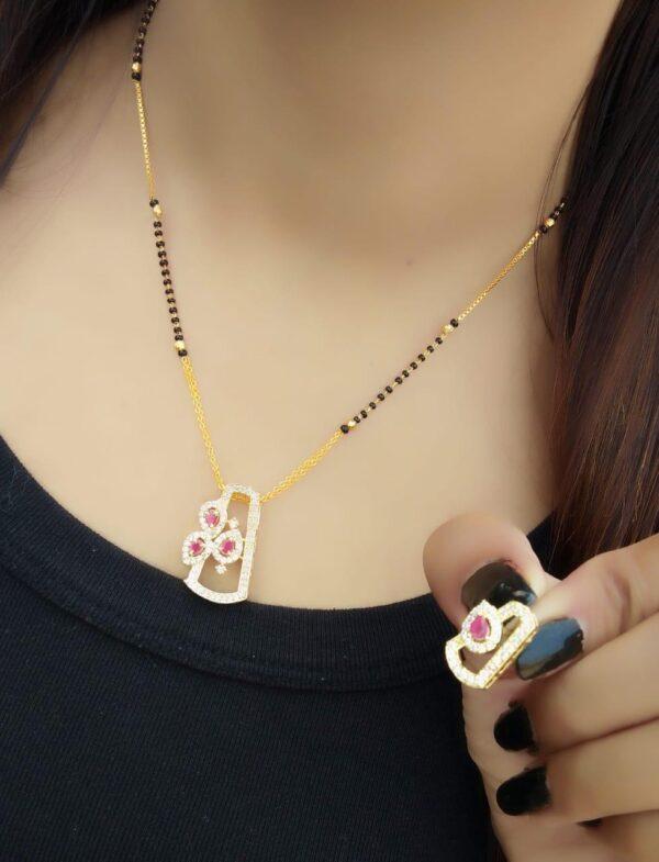 Wonderful White & Pink Diamond Golden Colored Artificial Mangalsutra Set Online