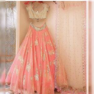 Exquisite Peach Nylon Net With Embroidered Work New Lehenga Choli Design Online