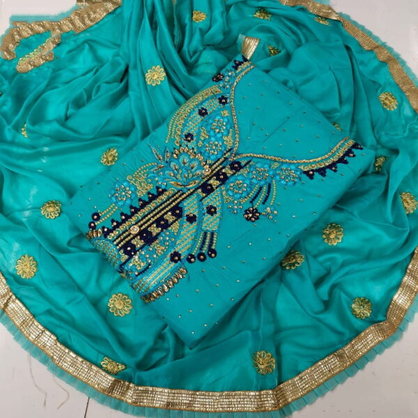 Striking Rama Cotton With Embroidered Work Suit