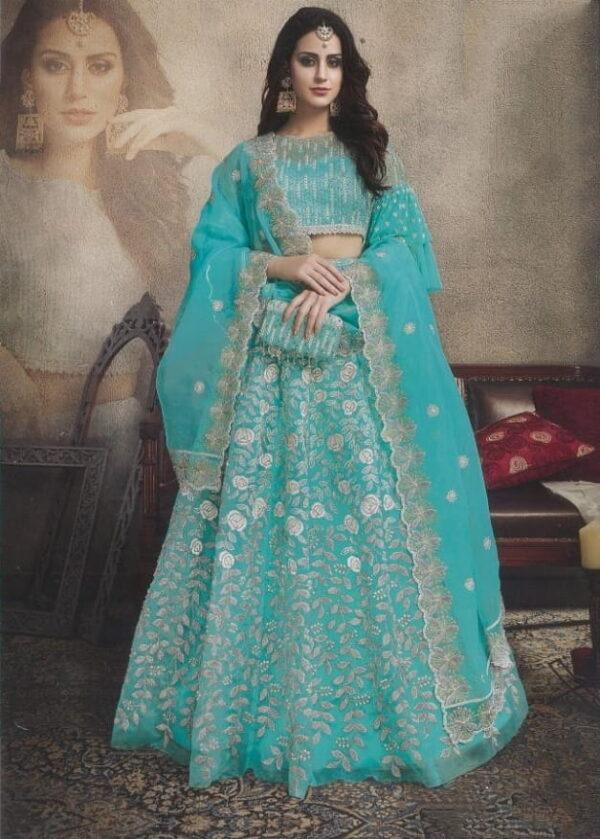 Sensational Firozi Color Wear Bridal Butterfly Net Stone Embroidered Designer Lehenga Choli