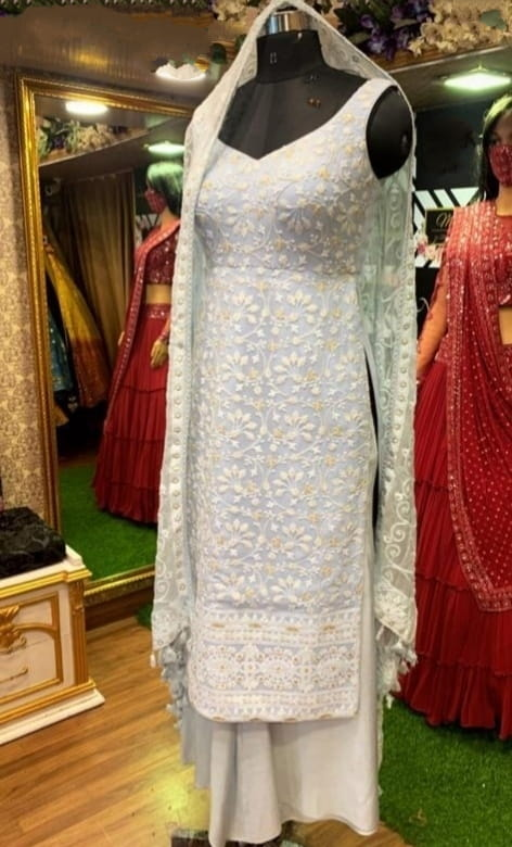 Bewitching White Color Designer Georgette Embroidered Semi Stitched Plazo Salwar Kameez