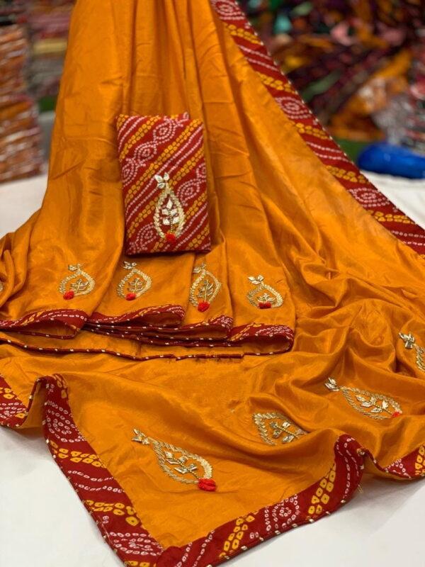 Good-Looking Mustard Color All Over Gotta Patti Butta Work Bandheni Lace Border Soft Dola Silk Saree Blouse