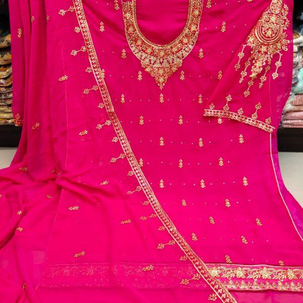 Wonderful Magenta Color Wedding Wear All Over Neck Embroidered Daman Lace Diamond Stone Work Faux Georgette Salwar Kameez