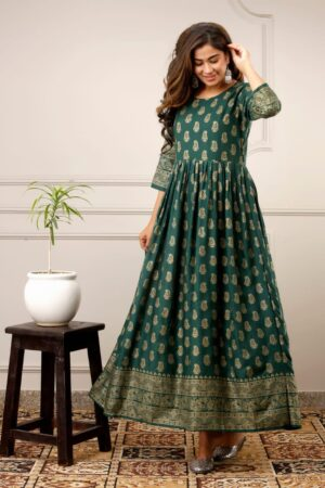 Alluring Dark Green Color Casual Wear Ready Made Fancy Golden Printed Rayon Gown